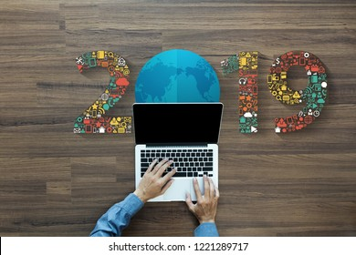 2019 new year business innovation technology set application icons, With businessman working on laptop computer PC, view from above