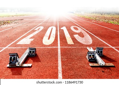 2019 new year celebration concept that is coming. Starting blocks of a racing lane to the horizon