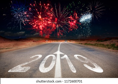 2019 New Year celebration fireworks on the road asphalt. New Year arrival concept