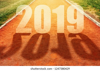 2019 New Year concept, number on athletic sport all weather running track in perspective
