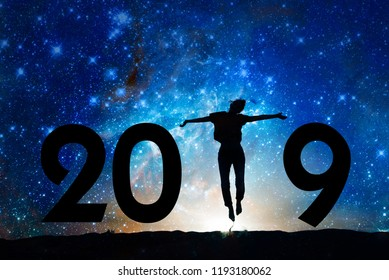 2019 new year greeting card. Silhouette of a woman jumping in the night, Starry sky background