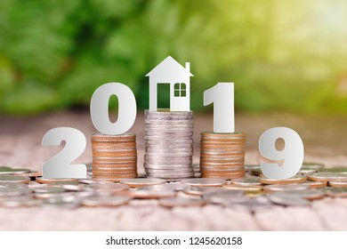 2019 New year on coins stack for saving money and financial planning concept, saving to buy a house