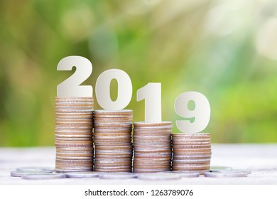 2019 New year on coins stack for saving money and financial planning concept