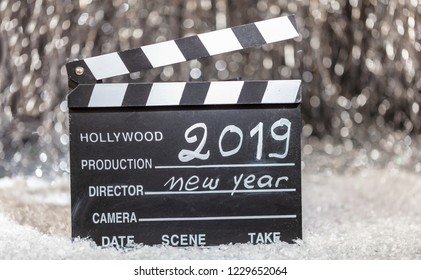 2019, new year on movie clapper, abstract bokeh lights background