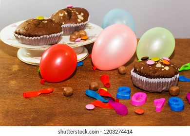 2019 new year party, chocolate arabic homemade cupcake, madeleine with colorful ballons and smarties