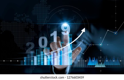 2019 New year planning business and financial concept. Businessman touching text number 2019 on growth graph chart and data, business strategy, banking and investment, digital marketing and payment.