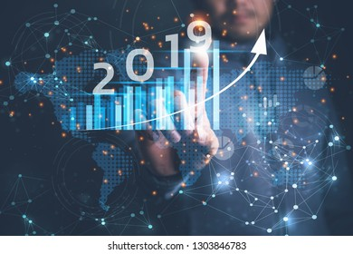 2019 New year planning business and financial concept. Businessman touching virtual screen on growth graph chart and data, business strategy, banking and investment, digital marketing and payment.