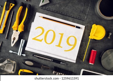 2019 New Year resolutions notebook with assorted DIY tools