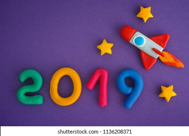 2019 New Year. Space rocket and Numbers are made out of play clay (plasticine).