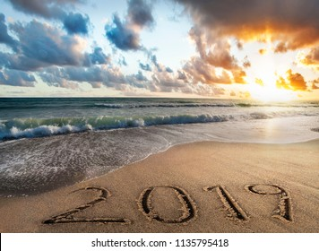 2019 new year text on their beach at su rise
