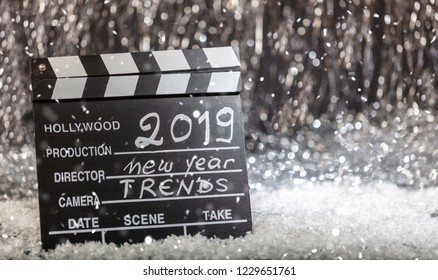 2019, new year trends on movie clapper, abstract bokeh lights background