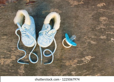2019 new year written laces of children's shoes and pacifier on old wooden background. Top view. Flat lay.