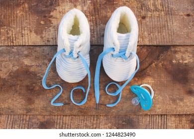 2019 new year written laces of children's shoes and pacifier on old wooden background. Top view. Flat lay.  Toned image.