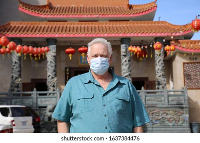 2019 Novel Coronavirus. 2019-nCoV. Wuhan China Coronavirus. A man wears a paper face mask to protect himself from contracting the Wuhan 2019 Novel Coronavirus. The 2019-nCoV is spreading world wide.