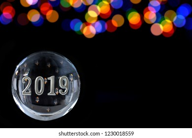 2019 in a Powerful magic sphere,Fortune teller,mind on black background with lbue and gold blurry light