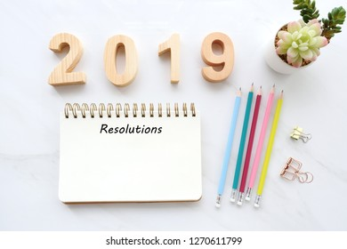 2019 resolution on blank notebook paper on white table background, 2019 new year mock up, template, flat lay