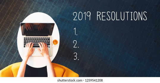 2019 Resolutions with person using a laptop on a white table