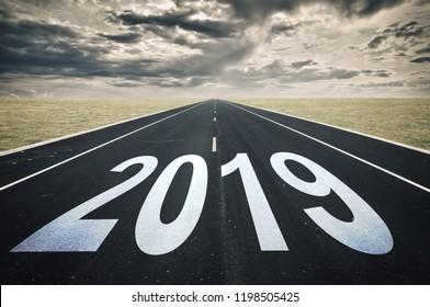 2019 Road perspective, dark clouds, crisis concept