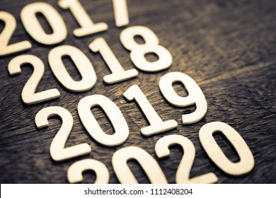 2019 in running year numbers on wood background