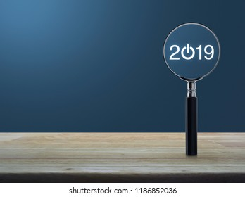 2019 start up flat icon with magnifying glass on wooden table over light blue gradient background, Business happy new year 2019 concept
