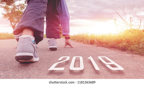 2019 symbolises the start into the new year.Start of people running on street,with sunset light.Goal of Success - Shutterstock ID 1181363689