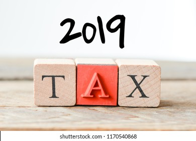 2019 TAX. Cube wooden block with alphabet building the word 2019 tax.