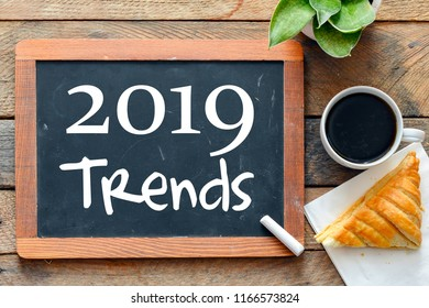 2019 trends text concept, wooden background