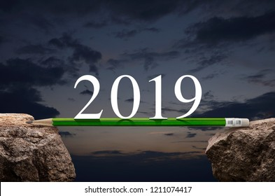 2019 white text with green pencil on rock over sunset sky, Business success strategy plan concept, Happy new year 2019 calendar cover