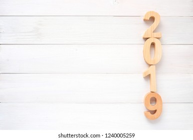 2019 wood letters on white wood background with copy space for text, 2019 new year greeting card banner