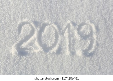 2019. Writings on the snow. Happy new year. Beautiful cold sunny winter day.  The game of light and shadow.