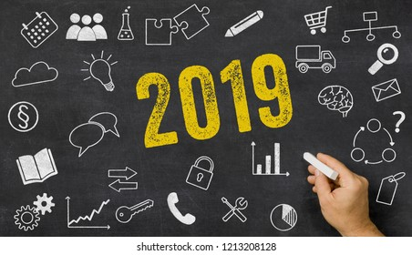 2019 written on a blackboard with icons