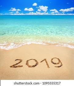 2019 written on sandy beach