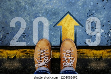 2019 Year Concept. Top View of Male with Leather Shoes standing on the Crossroad to Steps into number and Forward Arrow
