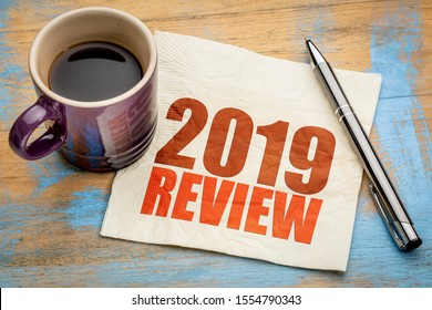2019 year review text on a napkin with a cup of coffee, end of year business concept