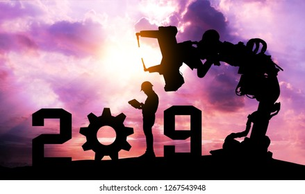 2019 years of robot assistant technology , industry 4.0 , artificial intelligence trend concept. Silhouette of business man control automation robo advisor arm with sunrise logistic bakckground.