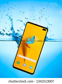 2019-03-17, Riga, Latvia. Samsung Galaxy S10+ dipped in water to showcase it's water resistance. Images shot for editorial use only.