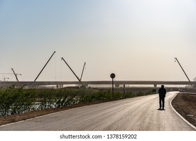 2019.04.22 Beijing, China. A construction worker walk on the street, new Beijing Daxing airport construction site in the remote