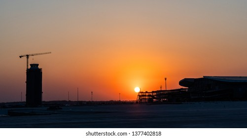 2019.04.22 Beijing, China  Beijing Daxing international airport construction site . 6pm sunset, shines golden color on the terminal.