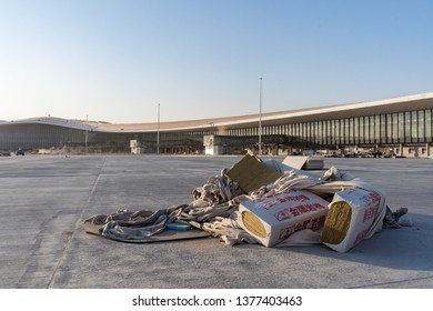 2019.04.22 Beijing, China  Beijing Daxing international airport construction site. The terminal half constructed shined under th sunset. A pile of rock wool was laid on the ground.