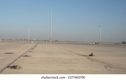 2019.04.22 Beijing, China  Beijing Daxing international airport construction site in the remote.  The light pole is installing. Pile of stones were layed on the ground to indicate distance