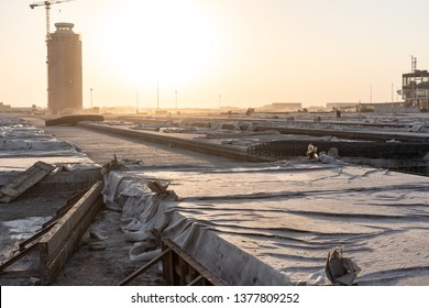 2019.04.22 Beijing, China  Beijing Daxing international airport construction site in the remote.  The control tower silhouette a shade. under the sun