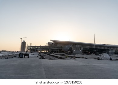 2019.04.22 Beijing, China  Beijing Daxing international airport construction site in the remote.  The control tower silhouette a shade. Sunset