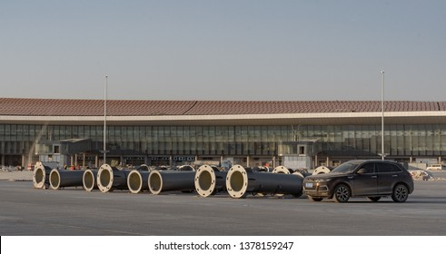 2019.04.22 Beijing, China  Beijing Daxing international airport construction site. The sign on the runway, Parts of the light pole laid on the ground