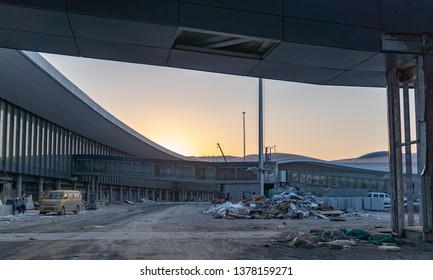 2019.04.22 Beijing, China  Beijing Daxing international airport construction site. Pile of construction waste waiting to be clean up . 6pm sunset