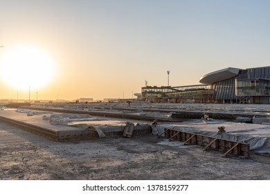 2019.04.22 Beijing, China  Beijing Daxing international airport construction site. Runway under construction. 6pm, Sunset shines golden color on everything