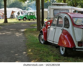 2019-06-08 , Bocholt Mussum, NRW, Germany. Traditional Pentecost meeting of 2cv and other vintage Citroen cars, 2cv Dolly in foreground, campground in the back
