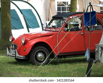 2019-06-09 , Bocholt Mussum, NRW, Germany. Traditional Pentecost meeting of 2cv and other vintage Citroen cars. Red 2cv in foreground