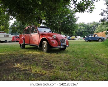 2019-06-10 , Bocholt Mussum, NRW, Germany. Traditional Pentecost meeting of 2cv and other vintage Citroen cars. Red 2cv in foreground