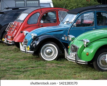 2019-06-10 , Bocholt Mussum, NRW, Germany. Traditional Pentecost meeting of 2cv and other vintage Citroen cars. Three 2cv are standing in line