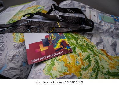 2019-07-10, San Diego. ESRI International User Conference map book and attendee badge.